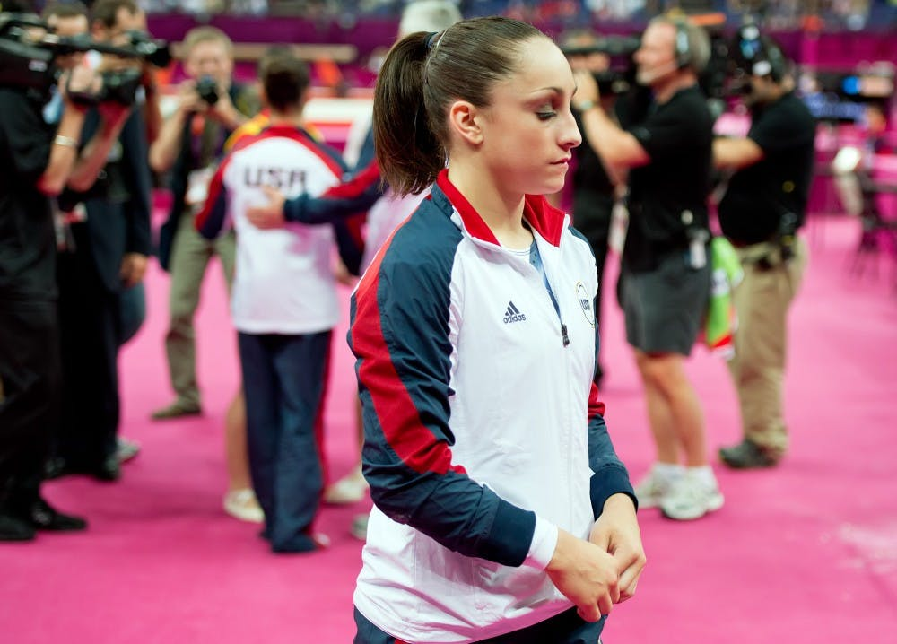 Jordyn Wieber of the United States, walked back to her seat after congratulating teammate Alexandra Raisman on her gold medal in the women's floor exercises apparatus finals at North Greenwich Arena during the 2012 Summer Olympic Games in London, England, Tuesday, August 7, 2012. Wieber finished seventh in the competition. (David Eulitt/Kansas City Star/MCT)