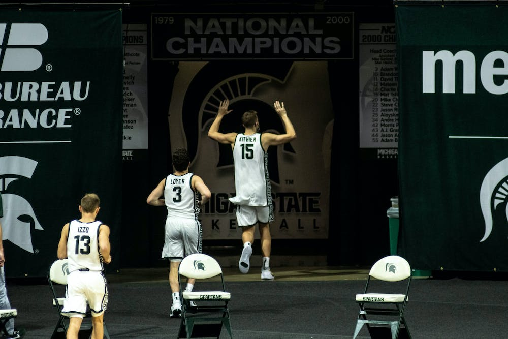 The Spartans run off the court after winning  the game against Eastern Michigan on Nov. 25, 2020 at the Breslin Center. The Spartans defeated the Eagles, 83-67.