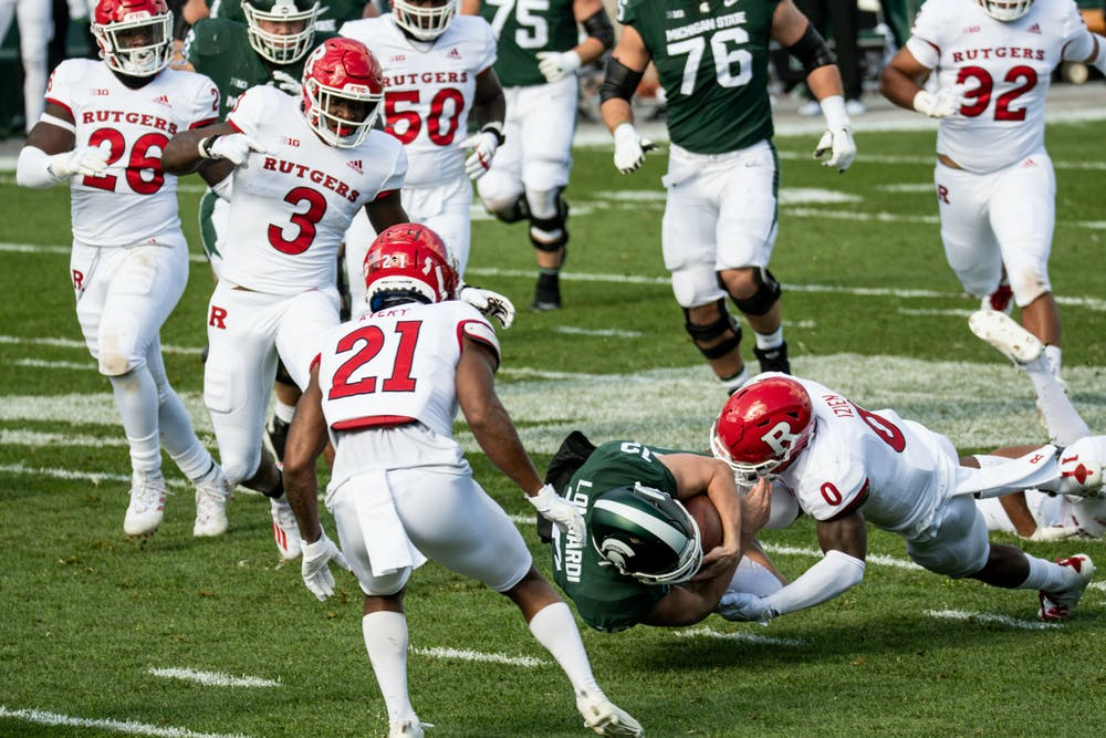 Quarterback, Rocky Lombardi, gets tackled in a game against Rutgers on Oct. 24, 2020.