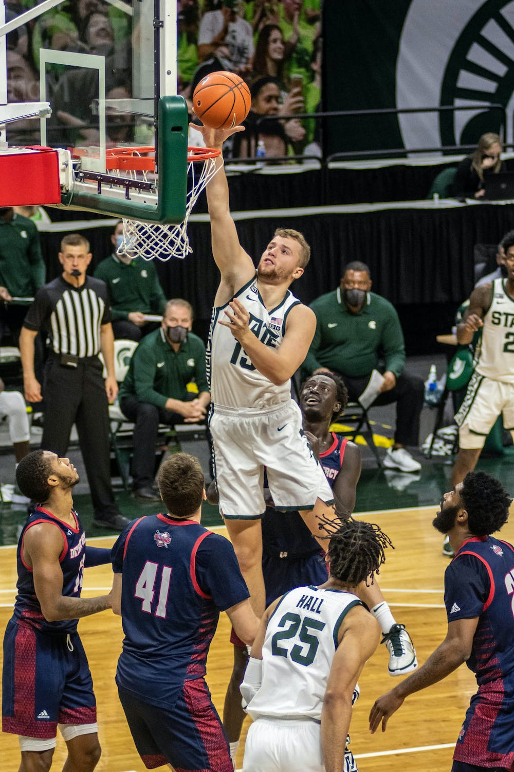 Junior forward Thomas Kithier (15) shoots the ball during the game against the Detroit Titans on Dec. 4, 2020 at the Breslin Center. The Spartans defeated the Titans, 83-76.