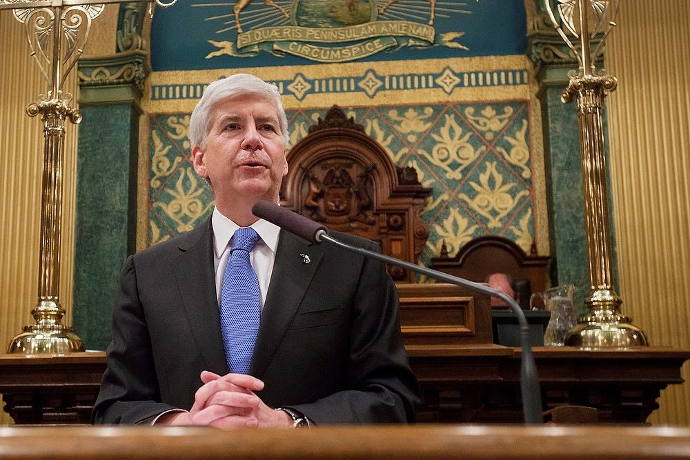 <p>Michigan Governor Rick Snyder addresses the audience Jan. 20, 2015, during the State of the State Address at the Capitol in Lansing, Michigan. Emily Nagle/The State News</p>