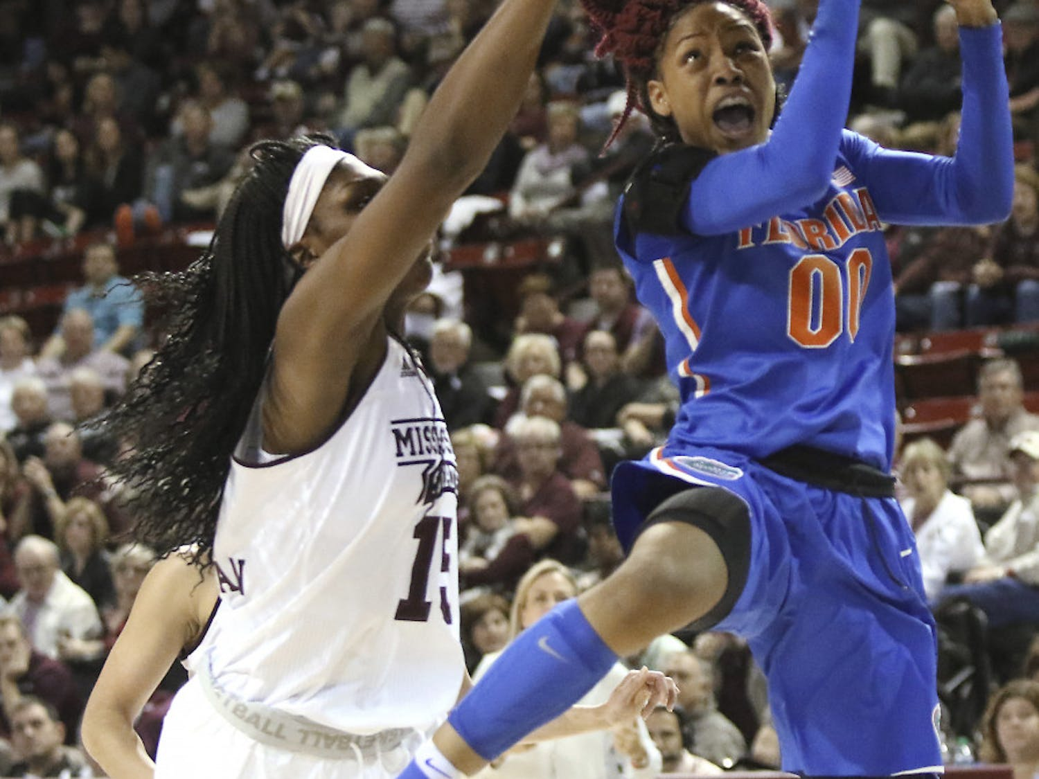 Florida guard Delicia Washington (0) drives to the basket around Mississippi State center Teaira McCowan (15) during the second half of an NCAA college basketball game in Starkville, Miss., Thursday, Jan. 12, 2017. (AP Photo/Jim Lytle)