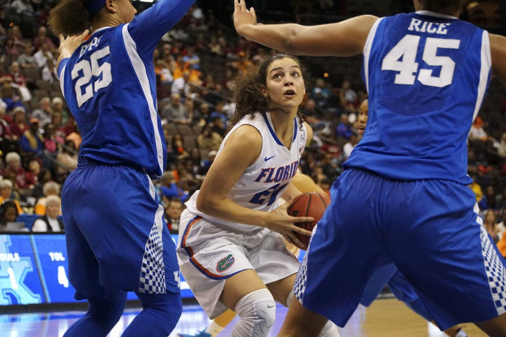 <p>Eleanna Christinaki looks to drive to the basket while two Kentucky players defend her during Florida's 92-69 loss to the Wildcats in the SEC Tournament quarterfinals on March 4, 2016, in Jacksonville.</p>