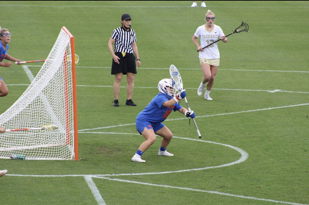 <p>Sarah Reznick guards her net during a rainy conference affair Friday against Vanderbilt</p>