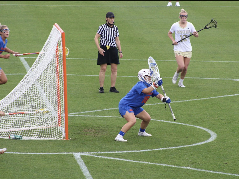 Sarah Reznick guards her net during a rainy conference affair Friday against Vanderbilt