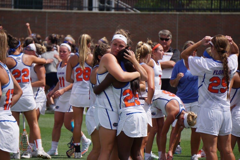 <p>Angela Flister (left) hugs Aniya Flanagan (right) after Florida was eliminated from the NCAA Tournament at Donald R. Dizney Stadium on Sunday.</p>