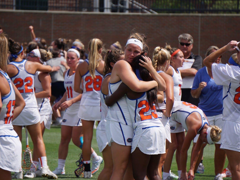 Angela Flister (left) hugs Aniya Flanagan (right) after Florida was eliminated from the NCAA Tournament at Donald R. Dizney Stadium on Sunday.