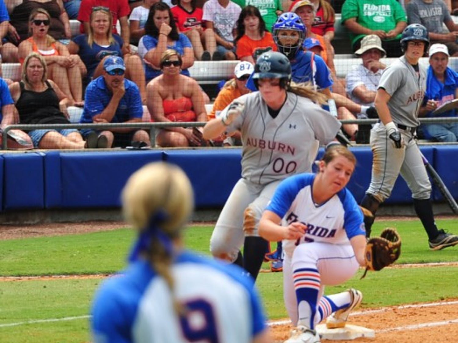 Florida right fielder Kasey Fagan throws out Auburn first baseman Caitlin Jordan during the top of the sixth inning of the Gators' 5-1 win on Sunday.