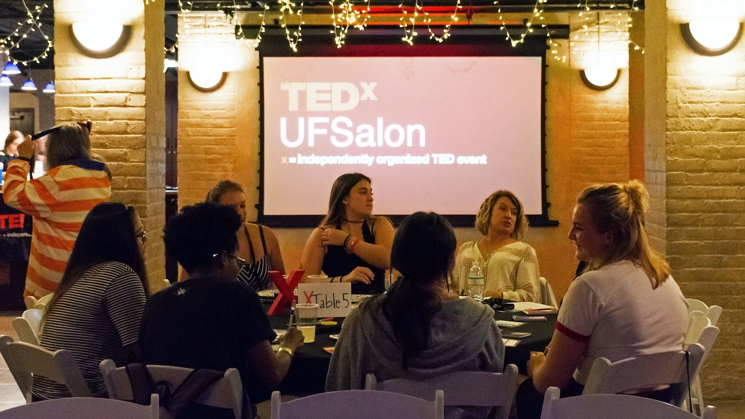 "UF students and Gainesville community members gather Tuesday evening to discuss inclusivity at TEDxUF's first salon of the semester, titled ""Who Tells the Story""."
