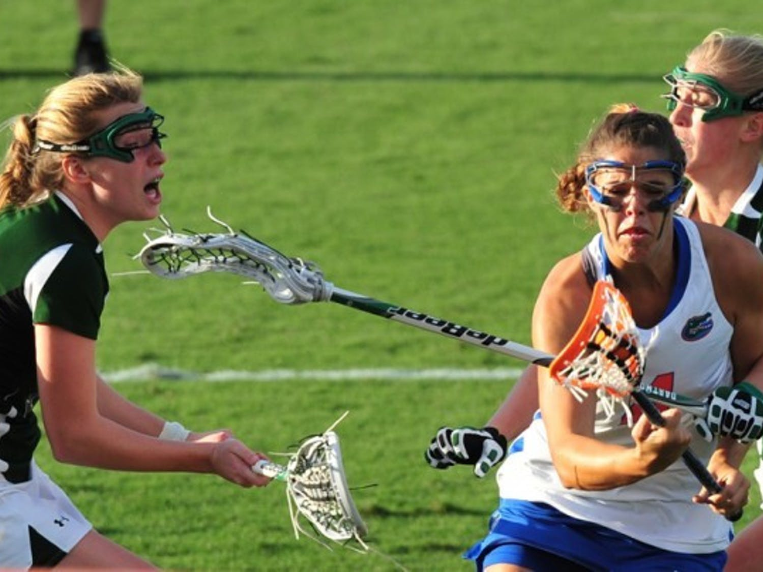 Kitty Cullen (4) drives toward the goal against Dartmouth on March 20. Cullen and Emily Dohony have both suffered head injuries this season but said they do not want helmets to be required.