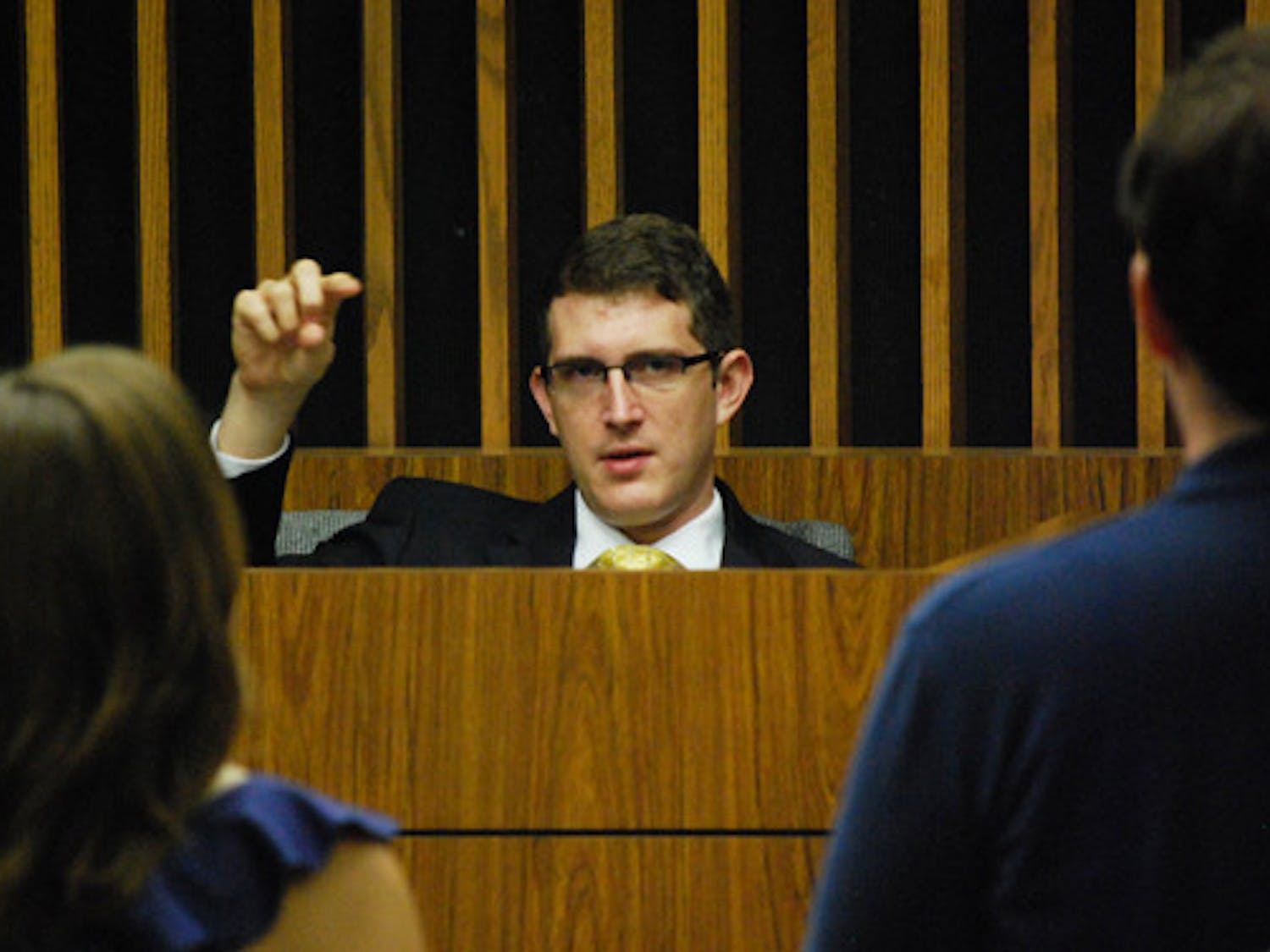 UF Supreme Court Associate Justice Tim Mason questions members of the Election Commission during Monday night's hearing. The Court decided to lift the injunction that had postponed the Student Senate's vote on whether to validate the Student Government elections.
