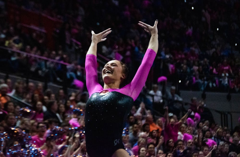 <p>Savannah Schoenherr sticks the landing during her floor routine against Alabama on Feb. 21, 2020. The junior scored a 9.825 on the vault and on bars in Florida's victory Friday night. </p>
