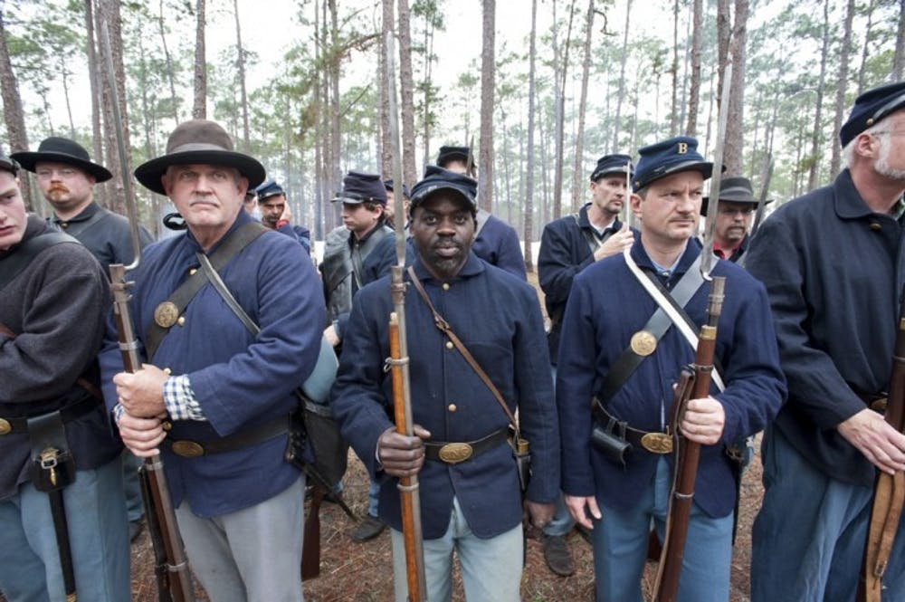 <p>Edgar McCray, of the 54th Regiment Massachusetts Volunteer Infantry, stands in formation during an afternoon inspection Saturday.</p> <p>&nbsp;</p>