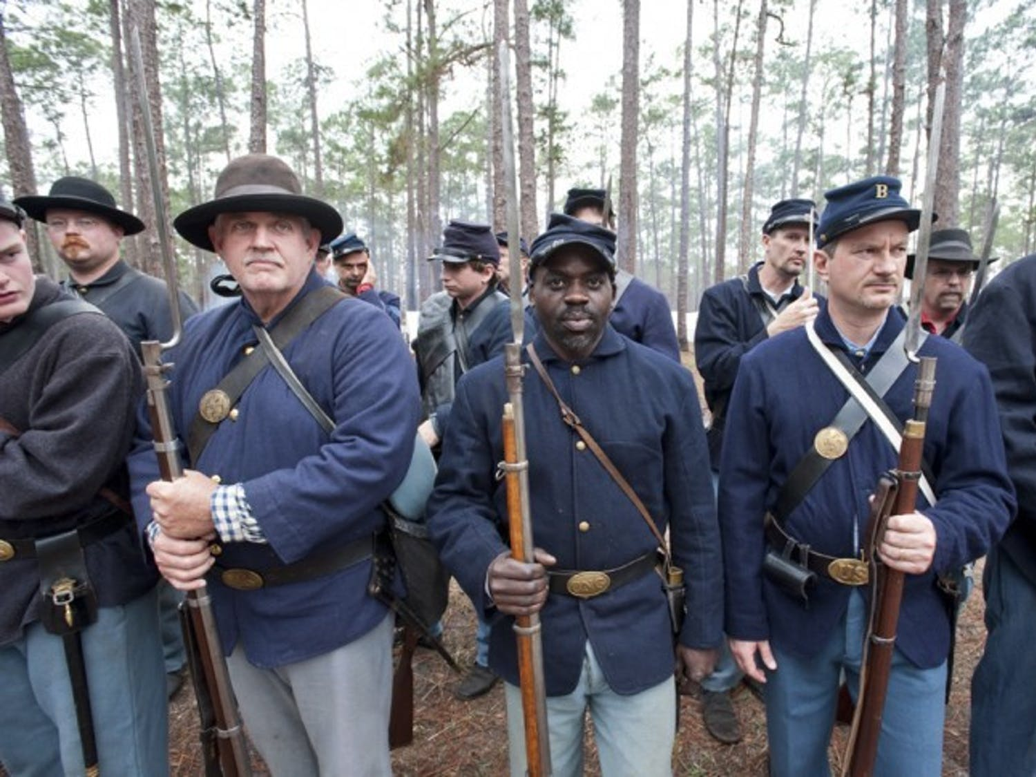 Edgar McCray, of the 54th Regiment Massachusetts Volunteer Infantry, stands in formation during an afternoon inspection Saturday.