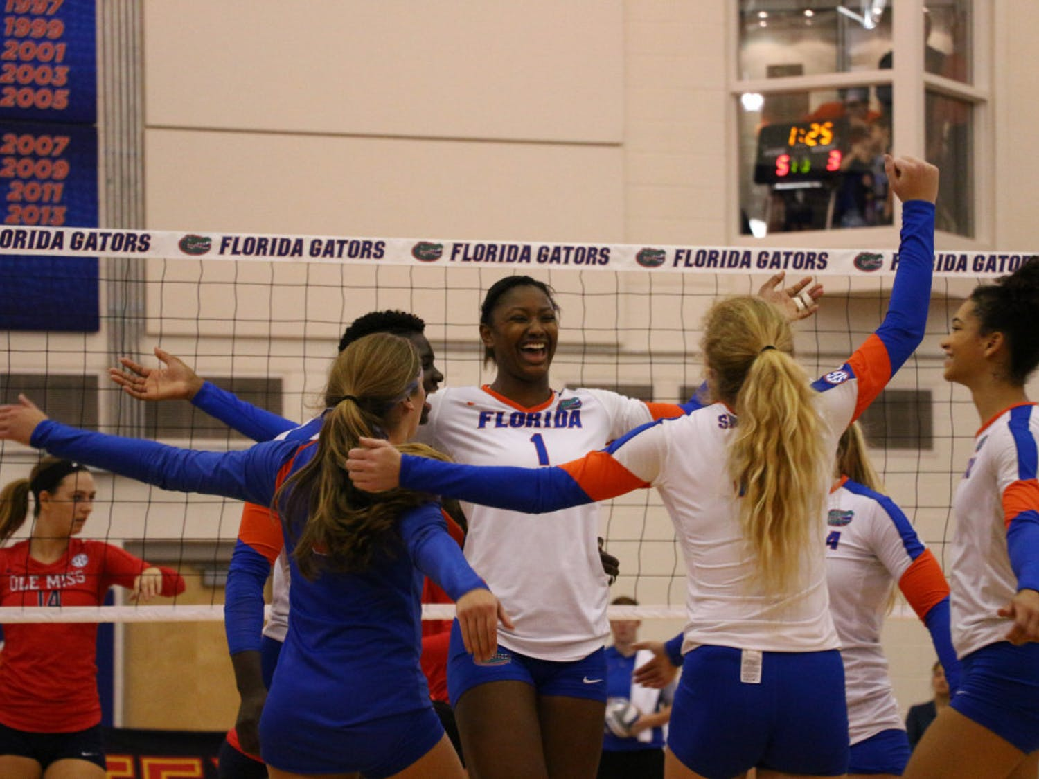 Rhamat Alhassan (1) celebrates with teammates during Florida's 3-0 win over Ole Miss on Oct. 28, 2016, in the Lemerand Center.
