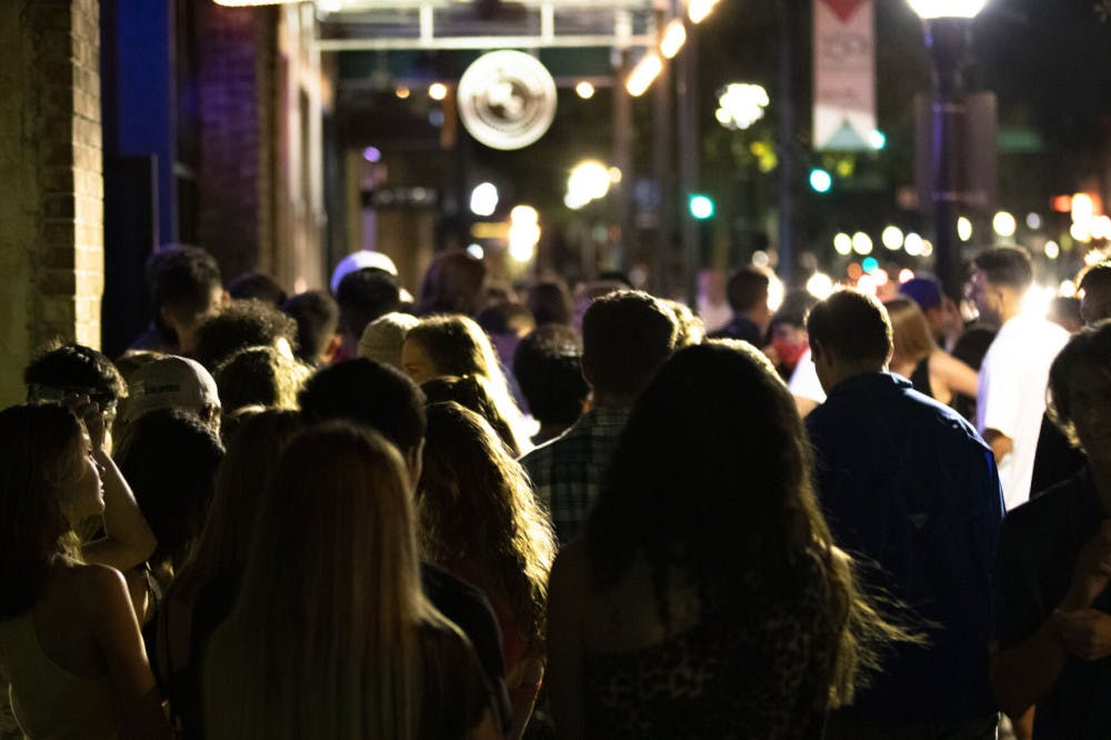 Photo of people lining up at Downtown Fats at night