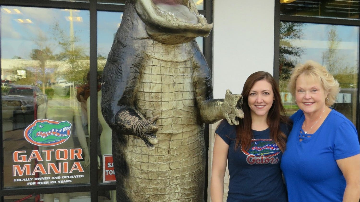 Lisa Blum and Jenice Bushnell stand in front of Gator Mania with their 12-foot fiberglass alligator. [Photo courtesy of Lisa Blum]