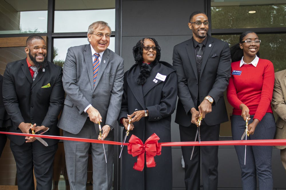 """<p dir=""""ltr""""><span>Carl Simien, UF President Kent Fuchs, Betty Stewart-Fullwood, William Atkins</span> <span>and</span> <span>Beaudelaine Mesadieu</span> <span>cut a ribbon Saturday, officially opening up the</span> <span>new Institute of Black Culture.</span></p><p><span></span></p>"""