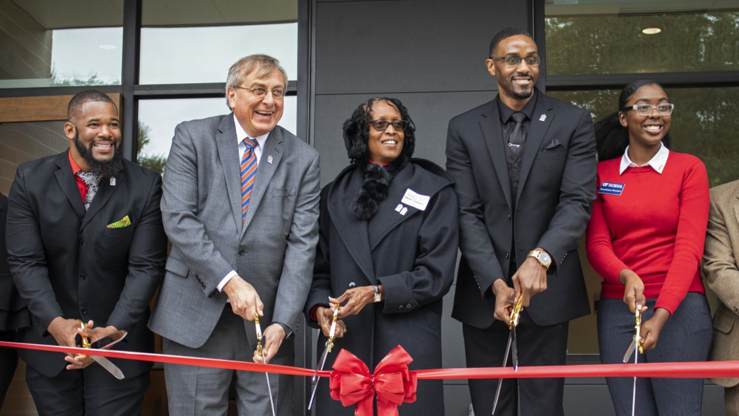 Carl Simien, UF President Kent Fuchs, Betty Stewart-Fullwood, William Atkins and Beaudelaine Mesadieu cut a ribbon Saturday, officially opening up the new Institute of Black Culture.