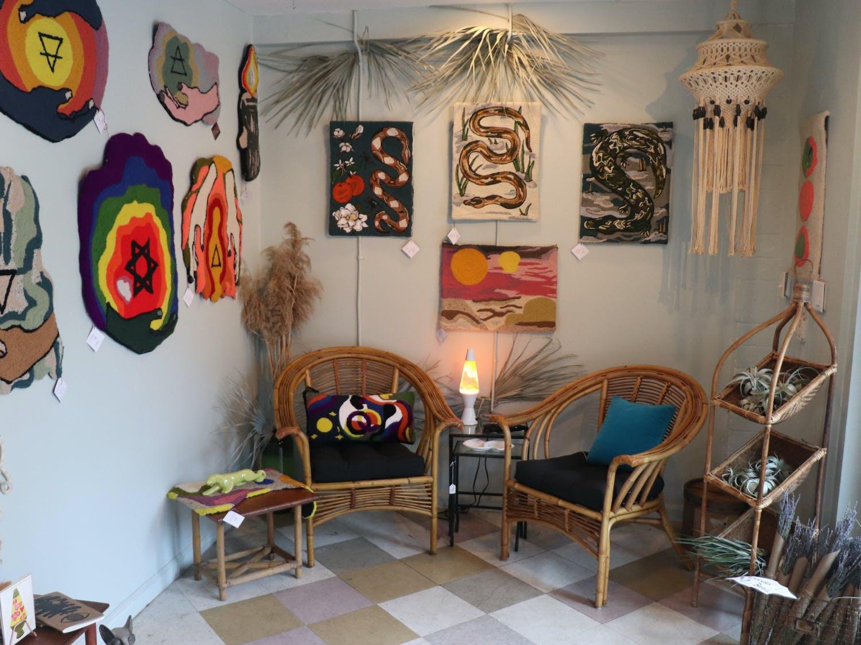 The artwork of Avery Bender, 35, owner of Phantom Fiber Wares, hangs for sale inside Auk Market on Wednesday, Sept. 15, 2021. Each fiber-based work takes anywhere from 15 to 60 hours to create.