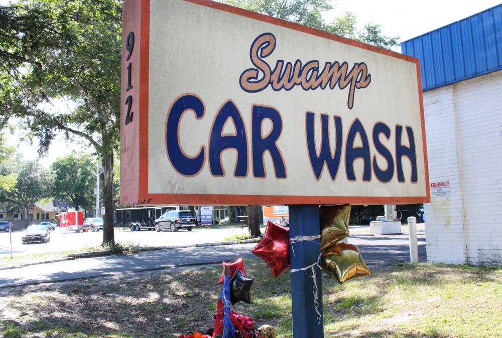 <p>Balloons were tied to the sign of Swamp Car Wash in memory of Bobby Hopkins Jr., on Thursday, May 27, 2021. </p>