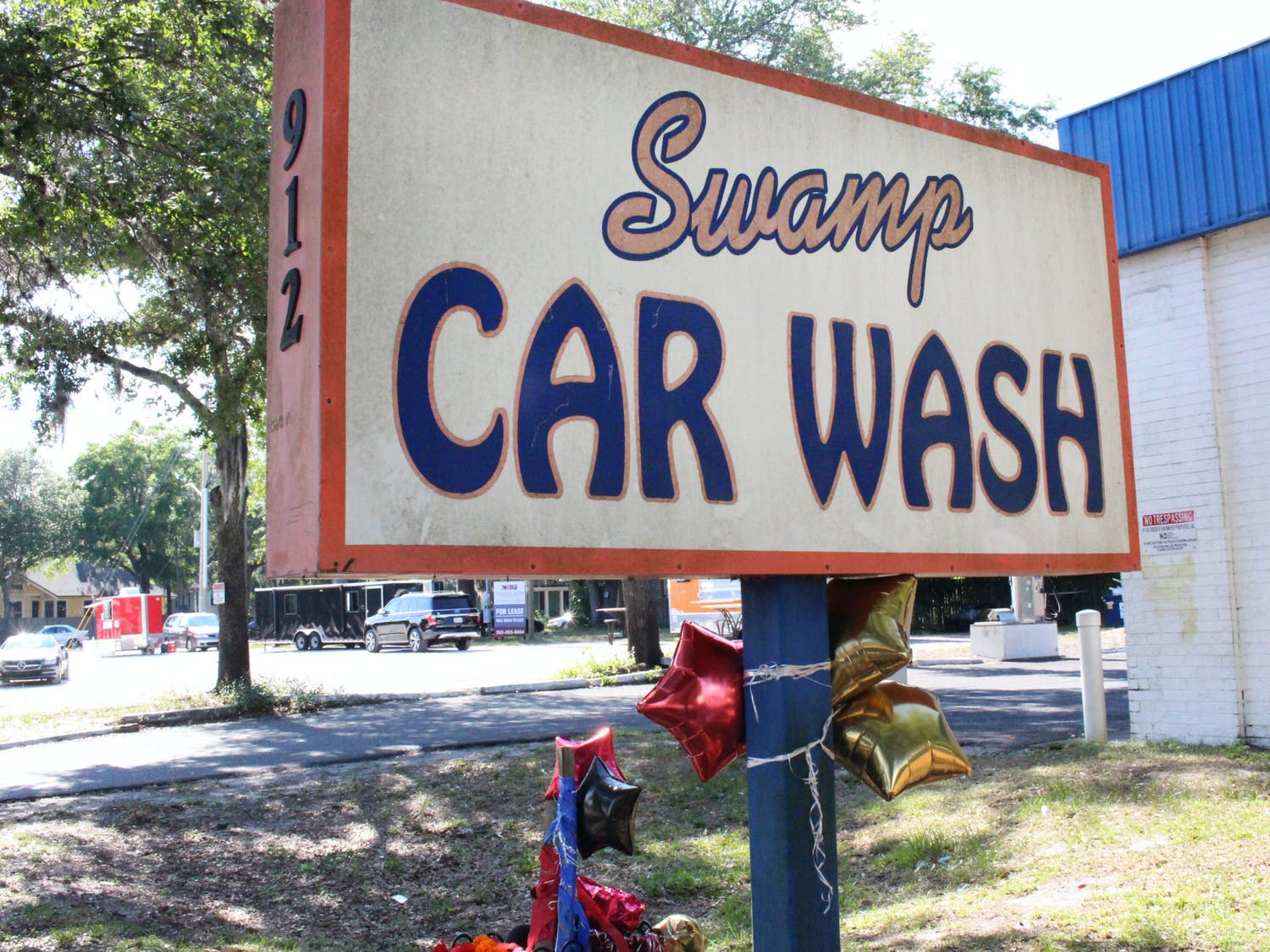 Balloons were tied to the sign of Swamp Car Wash in memory of Bobby Hopkins Jr., on Thursday, May 27, 2021.