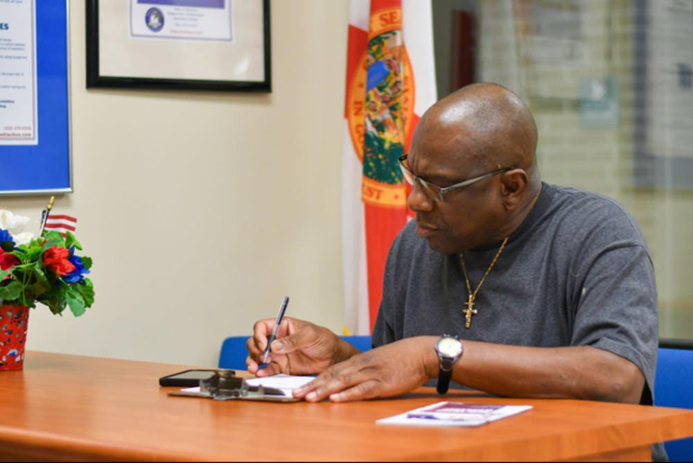"""<p dir=""""ltr""""><span>Harry Jones, a 61-year-old formerly incarcerated Alachua County resident, registers to vote Tuesday, Jan. 8, 2019, at the Alachua County Supervisor of Elections office. Jones, who has been out of prison for 13 years, had his right to vote restored after Amendment 4 passed in the 2018 midterm election. Tuesday was the first day Amendment 4 was put into effect. About 50 people registered to vote in Alachua County, said TJ Pyche, the elections office spokesperson.</span></p>"""