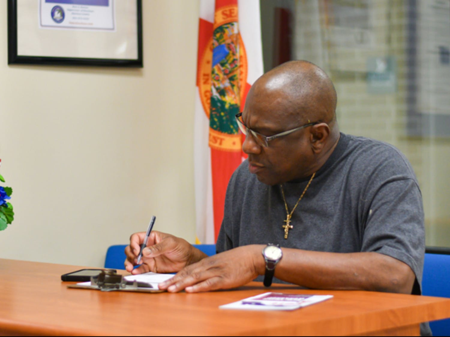 Harry Jones, a 61-year-old formerly incarcerated Alachua County resident, registers to vote Tuesday, Jan. 8, 2019, at the Alachua County Supervisor of Elections office. Jones, who has been out of prison for 13 years, had his right to vote restored after Amendment 4 passed in the 2018 midterm election. Tuesday was the first day Amendment 4 was put into effect. About 50 people registered to vote in Alachua County, said TJ Pyche, the elections office spokesperson.