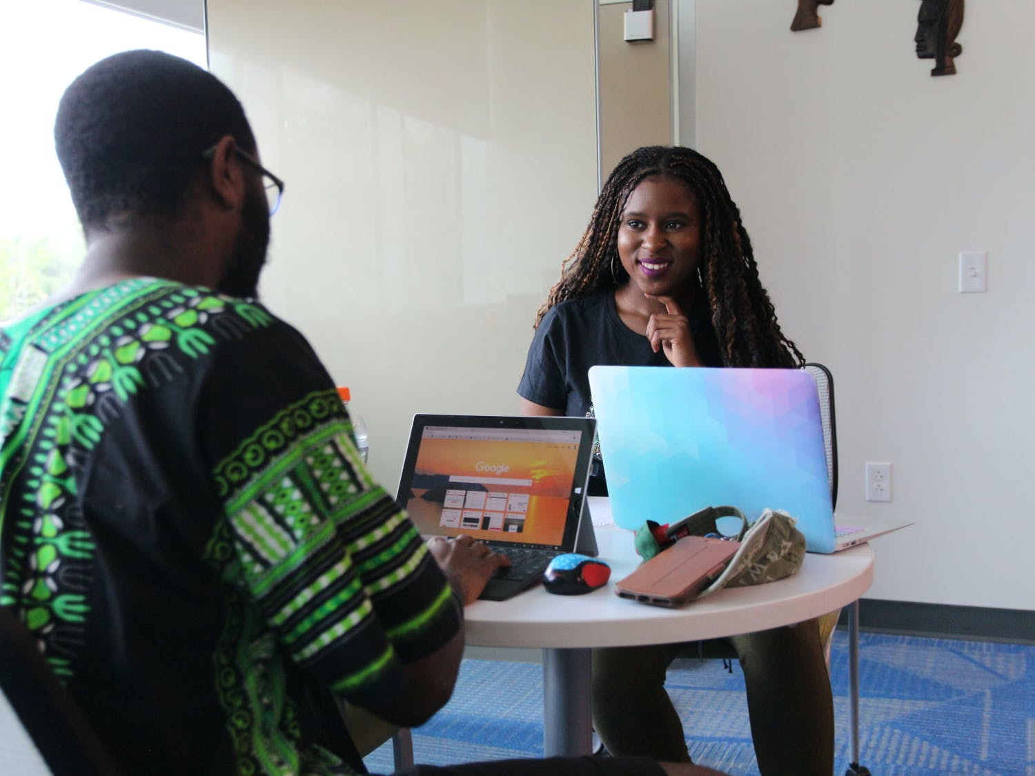 Daniel Clayton, 23, UF electrical engineering senior, speaks to Ashley Marceus, 21, UF triple major in political science, African American studies and women's studies third year about organizational planning inside the Black Enrichment Center on Tuesday afternoon.