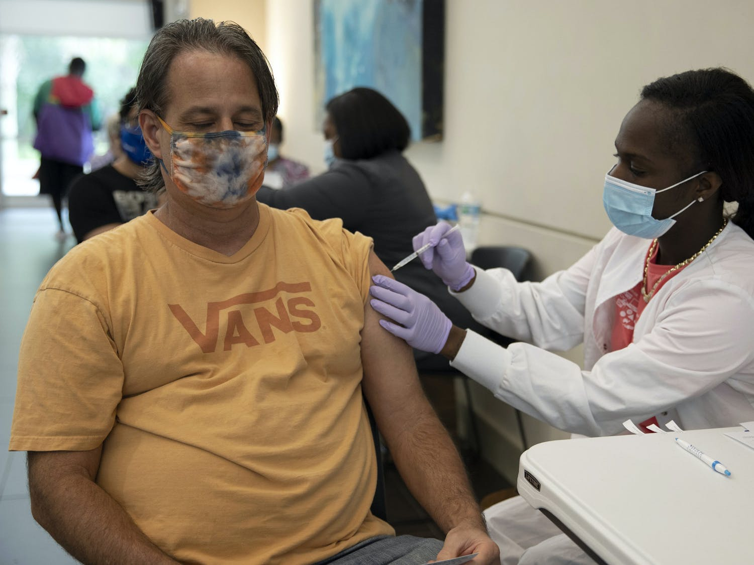 Scott Murphey, 52, a Santa Fe college math department professor, gets his second dose of the COVID-19 vaccine Thursday morning at Santa Fe College Jackson N. Sasser Fine Arts Hall, Gainesville, Fla., May 13, 2021.