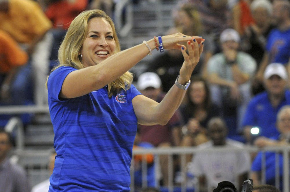 <p>UF women's basketball coach Amanda Butler Gator Chomps after being introduced at Gators Madness on Oct. 2, 2015, in the O'Connell Center.</p>