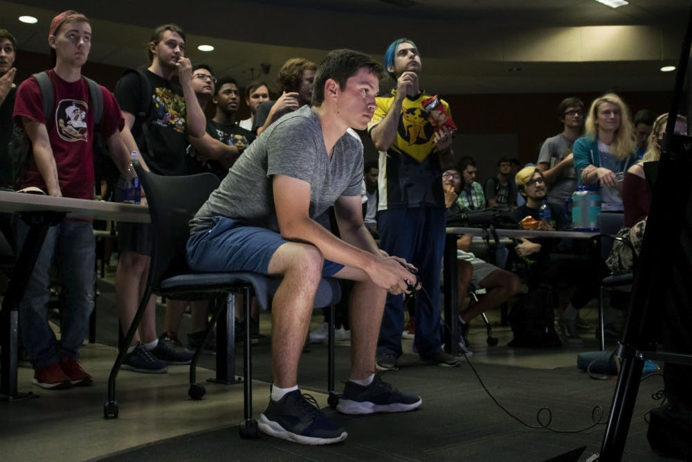"""<p style=""""line-height: 1.38; margin-top: 0pt; margin-bottom: 0pt;"""" dir=""""ltr""""></p><p>Ryan Erickson, a 19-year-old electrical engineering student, plays Super Smash Bros. Ultimate Friday night during a tournament held in Turlington. Erickson, who goes by the gamertag """"Poet,"""" is one of Gainesville's top competitive Smash players and is currently ranked as the 4th best player in North Florida. He has competed in local, statewide and nationwide tournaments.</p>"""