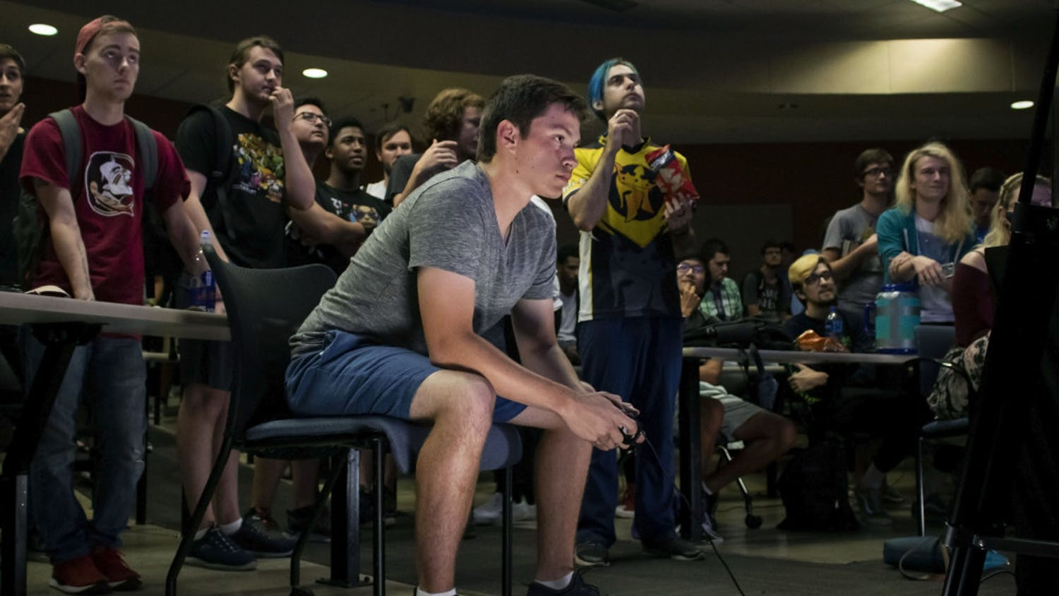 "Ryan Erickson, a 19-year-old electrical engineering student, plays Super Smash Bros. Ultimate Friday night during a tournament held in Turlington. Erickson, who goes by the gamertag ""Poet,"" is one of Gainesville's top competitive Smash players and is currently ranked as the 4th best player in North Florida. He has competed in local, statewide and nationwide tournaments."