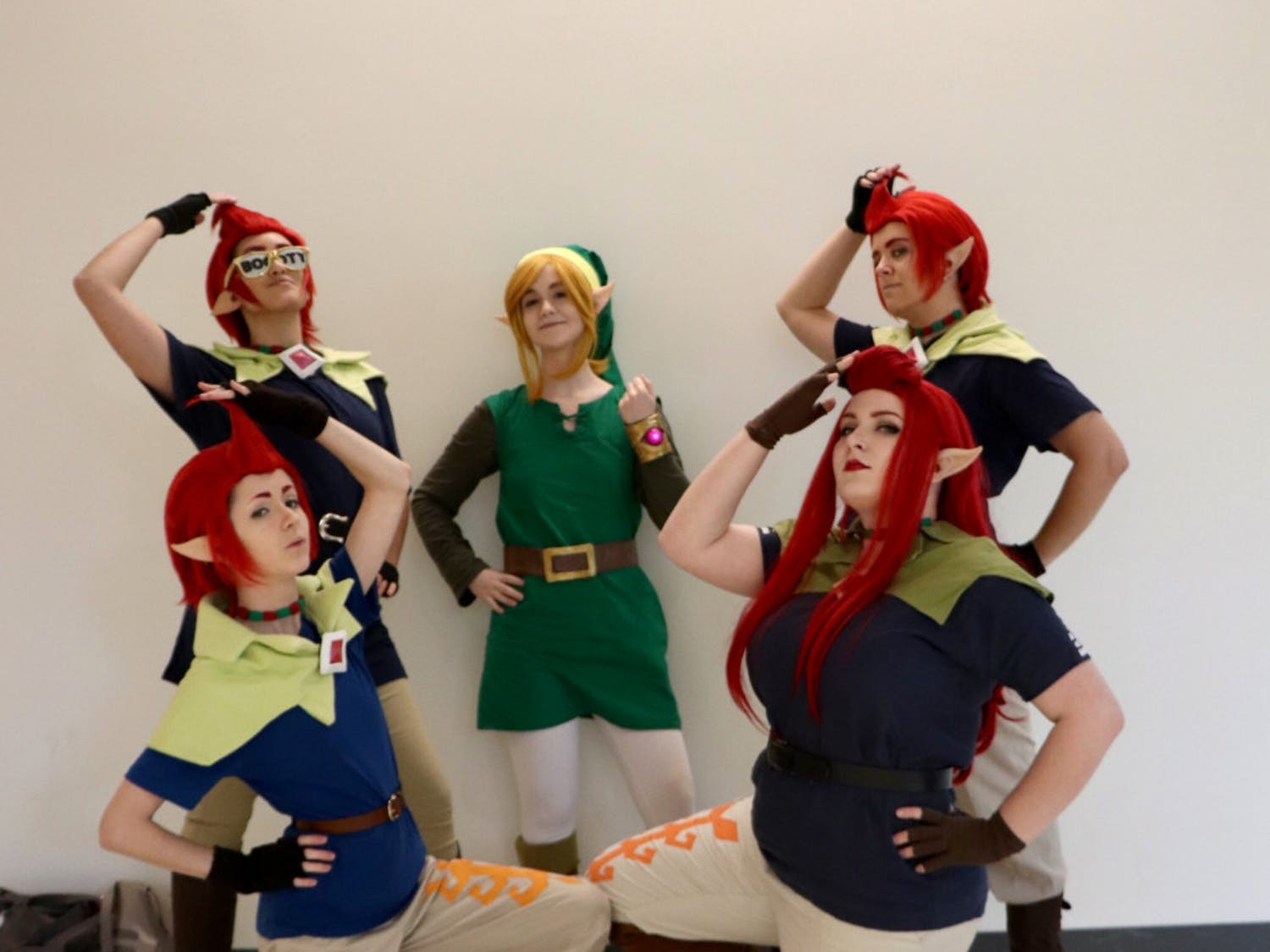 "Link and the Groose FlockLeft to Right Names: Maddie Langguth, Kim Cruz, Katrina Lundquist , Keira McDonald and Kaitlin Duggan.The five planned this group cosplay a year in advance as an inside joke. Lundquist cosplays as Link, a character from ""The Legend of Zelda"" series, and the remaining four ladies dress up as Groose, who appears in ""The Legend of Zelda: Skyward Sword.""According to Duggan, the group spent three hours working on their costumes in their hotel room. They have attended multiple conventions as Link and the Groose Flock.""It's nice we're a joke cosplay every once in a while,"" said Duggan.The group advises first-time cosplayers to have fun and to plan ahead.""Start early,"" said McDonald. ""Do not 'con crunch' and don't start your cosplay in three hours possibly in a hotel room."""