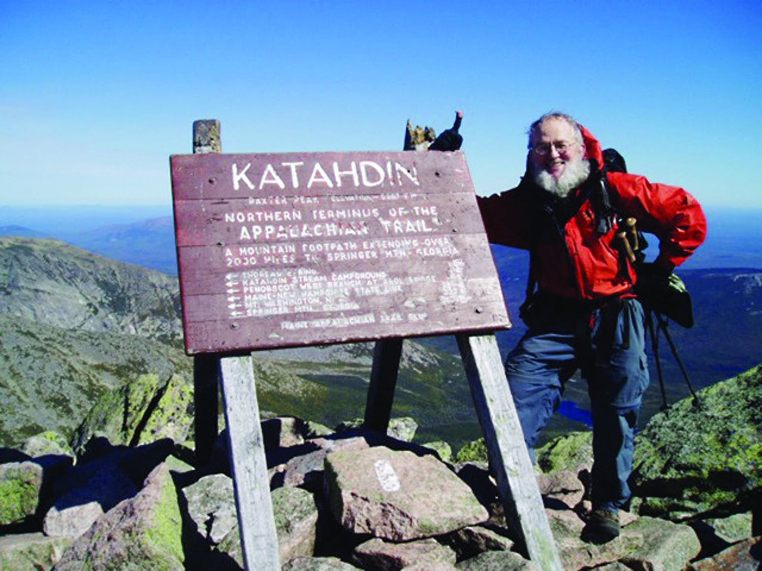 Dr. Bill Luttge poses at the northern end of the Appalachian Trail on the top of Mount Katahdin in Baxter State Park in Millinocket, Maine in 2004.