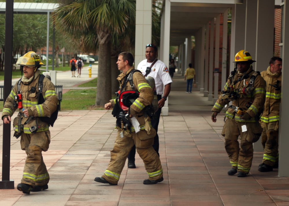 """<p><span>Gainesville Fire Rescue firefighters come out of the Biomedical Sciences Building in bunker gear after assessing the chemical spill on</span><span class=""""aBn"""" data-term=""""goog_997767193""""><span class=""""aQJ"""">Monday, Nov. 5, 2018</span></span><span>. The spill was contained within the fume hood and the hazmat team determined that the room was safe.</span></p>"""