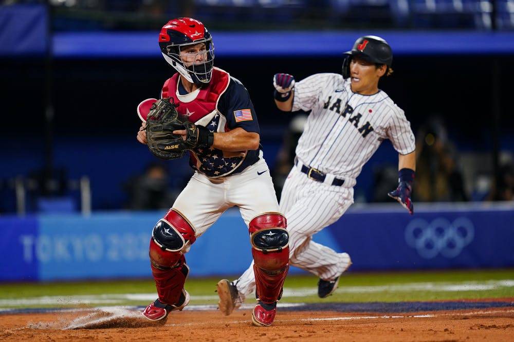 United States catcher Mark Kolozsvary forces out Japan's Masataka Yoshida on a fielder's choice by Japan's Yuki Yanagita during the gold medal baseball game at the 2020 Summer Olympics, Saturday, Aug. 7, 2021, in Yokohama, Japan. (AP Photo/Matt Slocum)