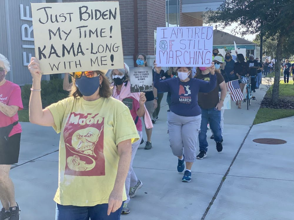 Picture of protesters marching with signs