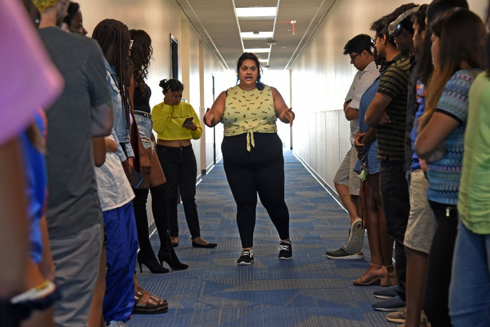 "<p dir=""ltr""><span>Yashu Rao, 27, a third-year UF materials science and engineering doctoral student, directs participants at the fashion rehearsal Thursday afternoon for the upcoming Indo-Western Fashion Show Oct. 18 at the Reitz Union Rion Ballroom.</span></p><p><span> </span></p>"