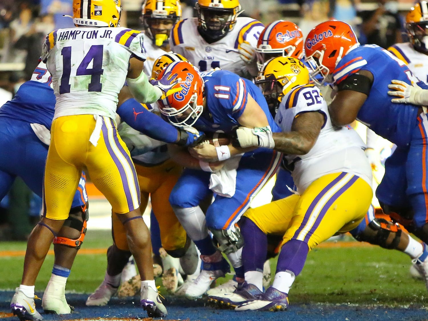 Gators quarterbacks Kyle Trask (11) runs the ball in for the Gators' first touchdown against LSU Saturday night. [Brad McClenny/The Gainesville Sun]