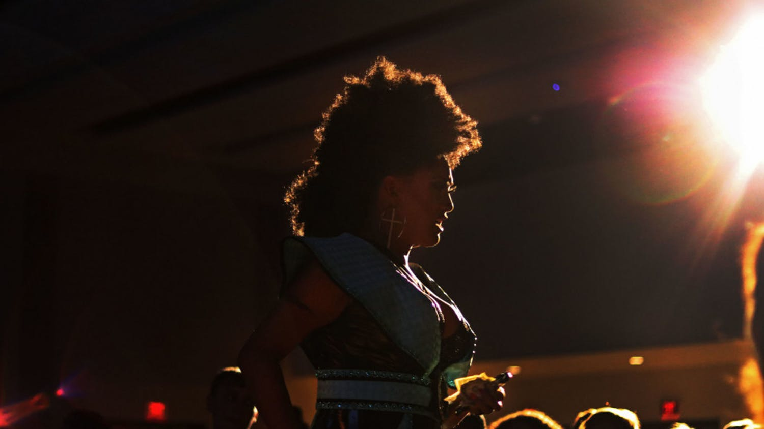 Faith Taylor walks into the crowd of over 250 people Monday night during the Illuminate show in the Rion Ballroom at the Reitz Union.