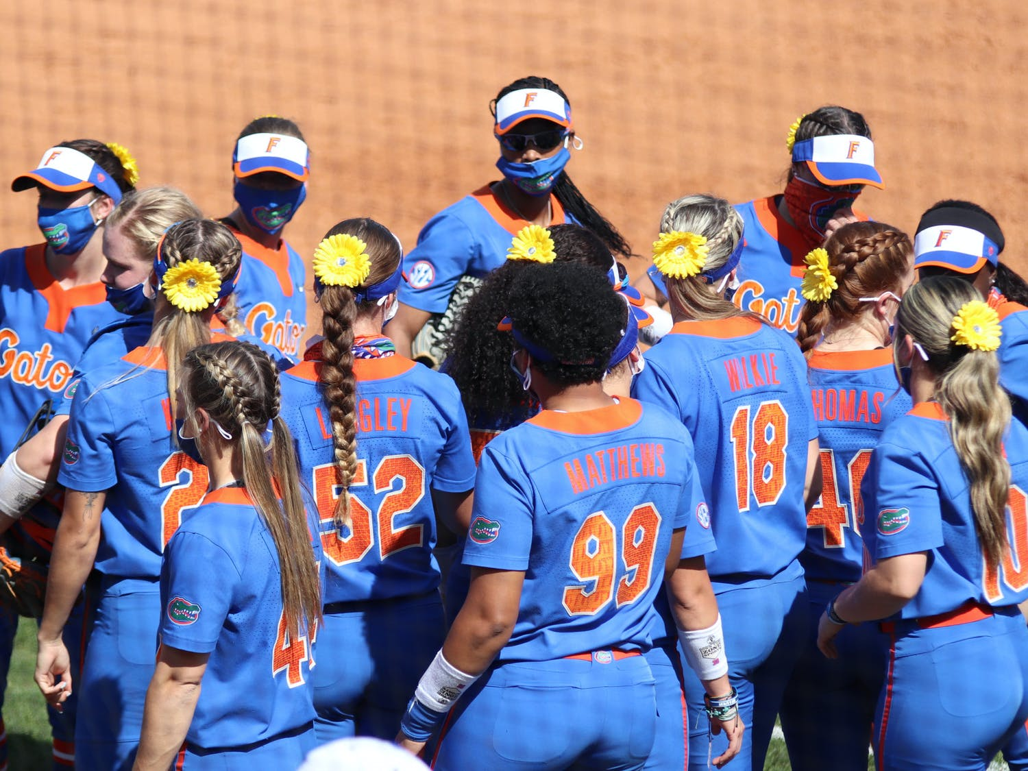 The Florida softball team huddles on February 27 in a game against Louisville. The Gators' season ended Saturday with a second straight Super Regional loss to Georgia.