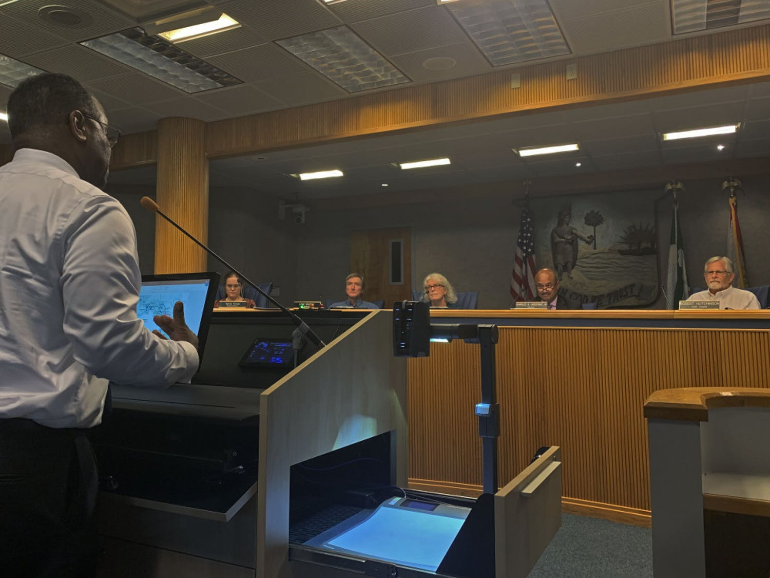 James McKnight, a 62-year-old Gainesville resident, speaks to county commissioners during public comment at a meeting on Tuesday evening. McKnight and his neighbors spoke about the lack of road maintenance at NE 27th Avenue in Northeast Gainesville.