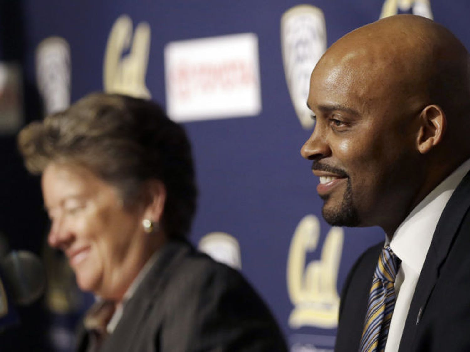 Former Tennessee men's basketball coach Cuonzo Martin (right) smiles as he is introduced as Cal's new coach at a press conference Tuesday in Berkeley, Calif.