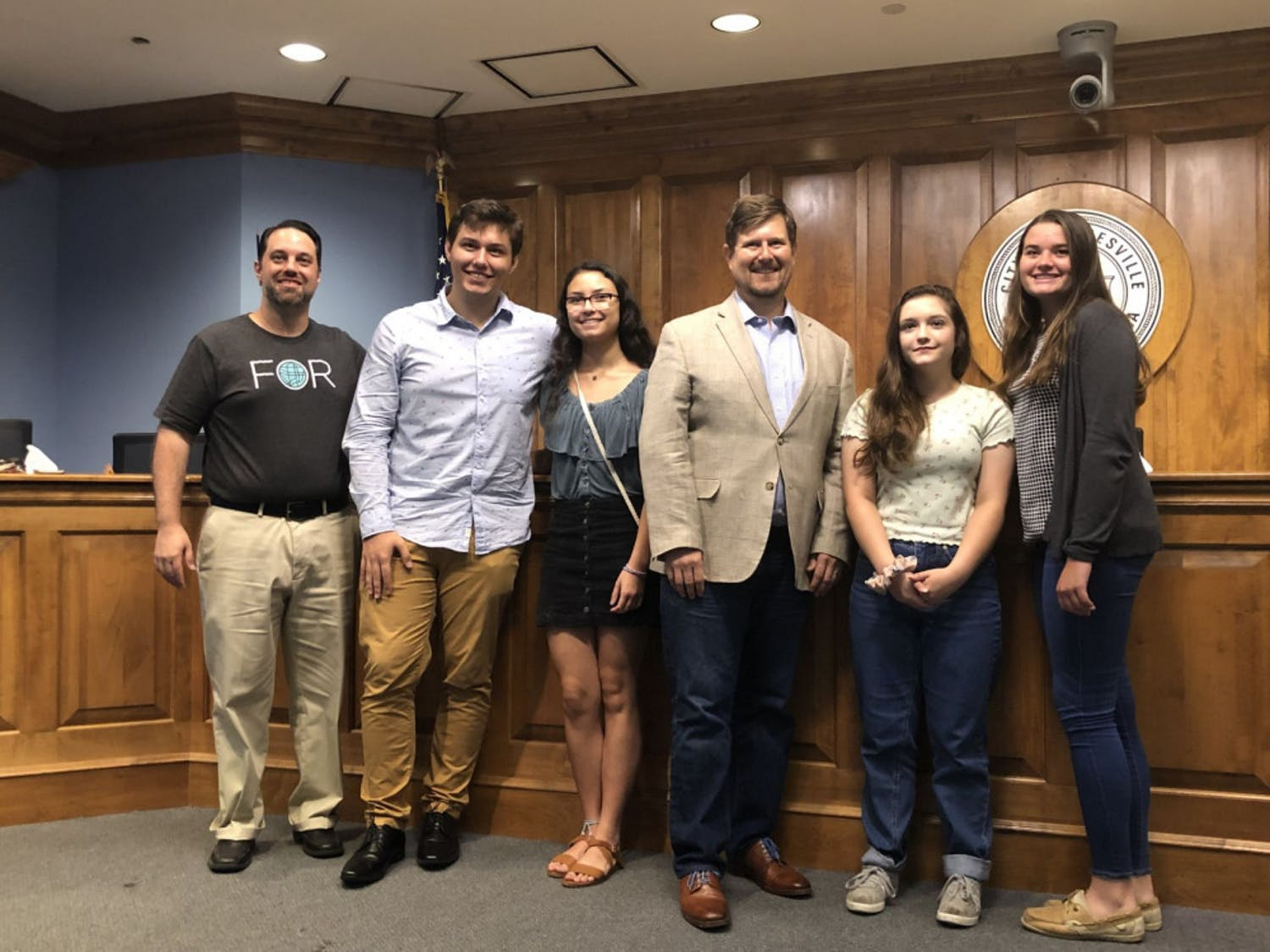 (Left to Right) Joshua Forgione, Matt Mann, Bella Wilson, Mayor Lauren Poe, Keelyn Fife and Alissa Humphrey pose for a photo after presenting their projects in the City Commission room.