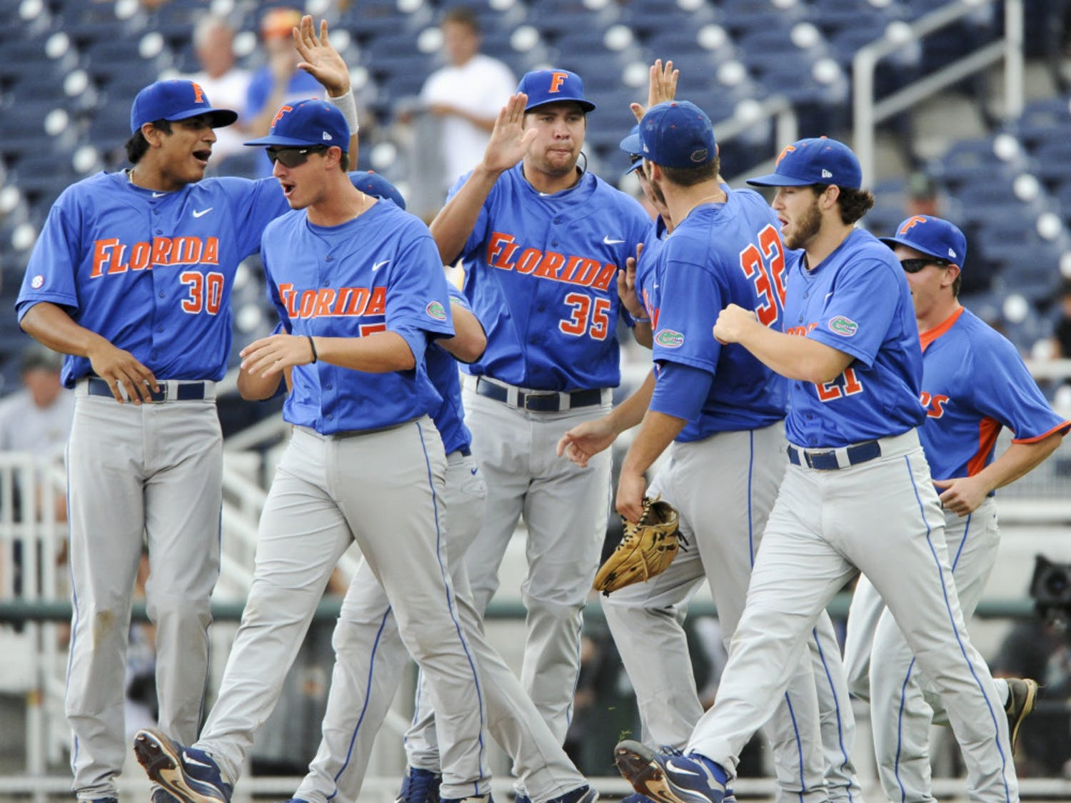 Florida celebrates after beating Vanderbilt 3-1 in a weather-delayed College World Series contest. The Gators dropped their SEC foes for the fourth time in five tries.