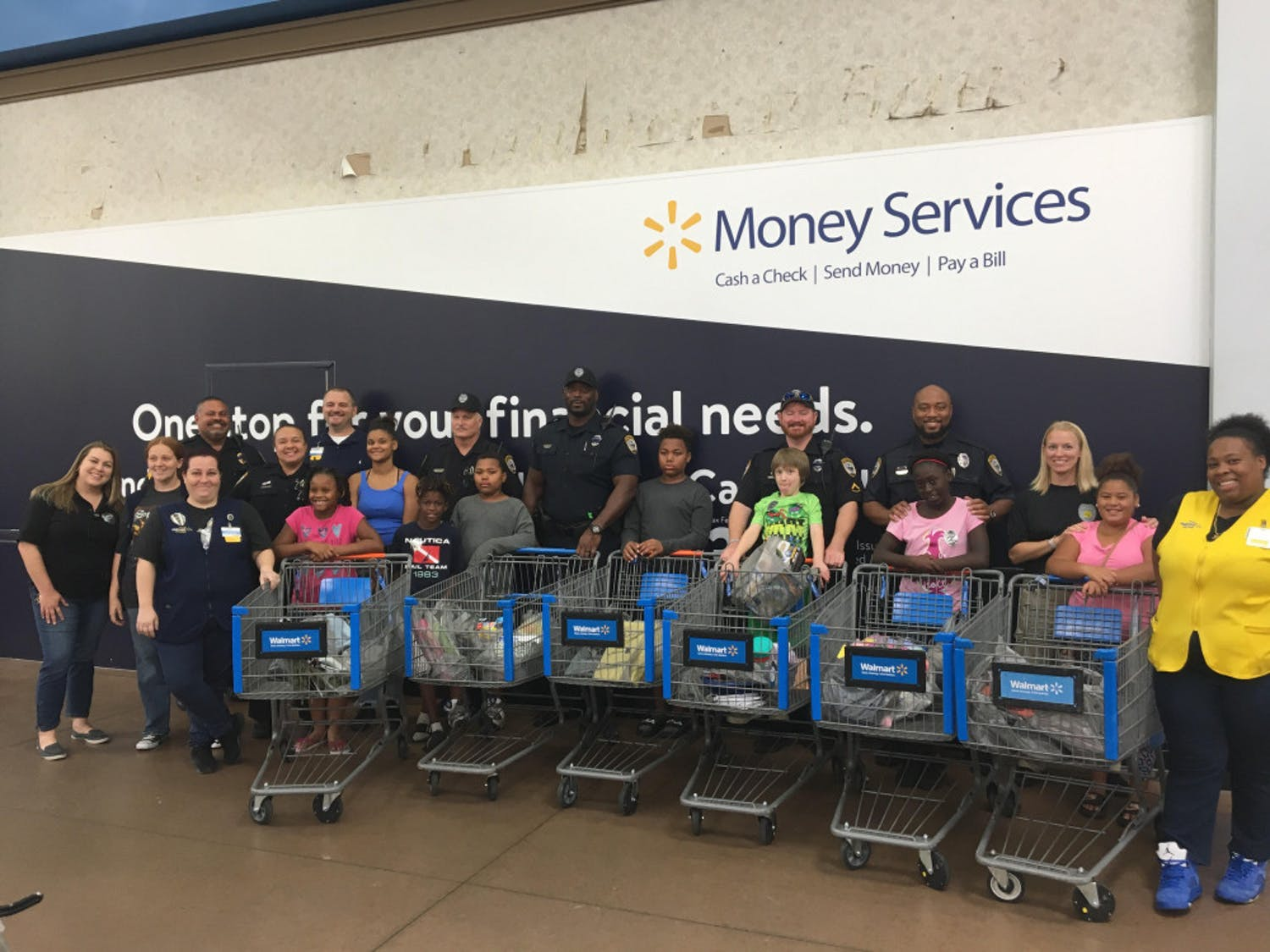 All of the GPD School Resource Officers with the children and their purchased items.