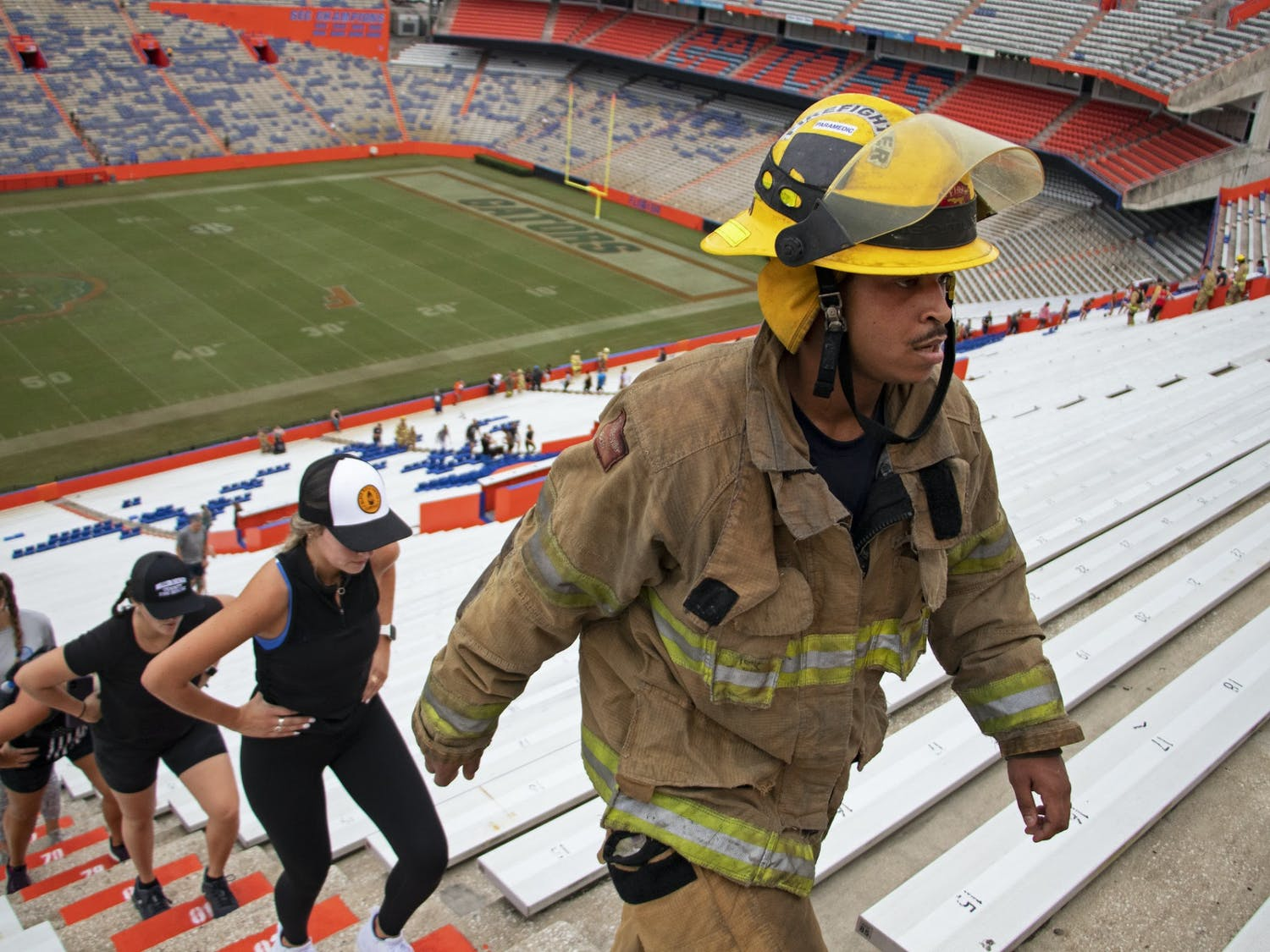"""Anthony """"Hutch"""" Hutchinson, Gainesville Fire Rescue first responder, marches up the stadium steps during the 5th Annual UF Collegiate Veterans Society 9/11 Memorial Stair Climb at Ben Hill Griffin Stadium on Saturday, Sept. 11, 2021."""
