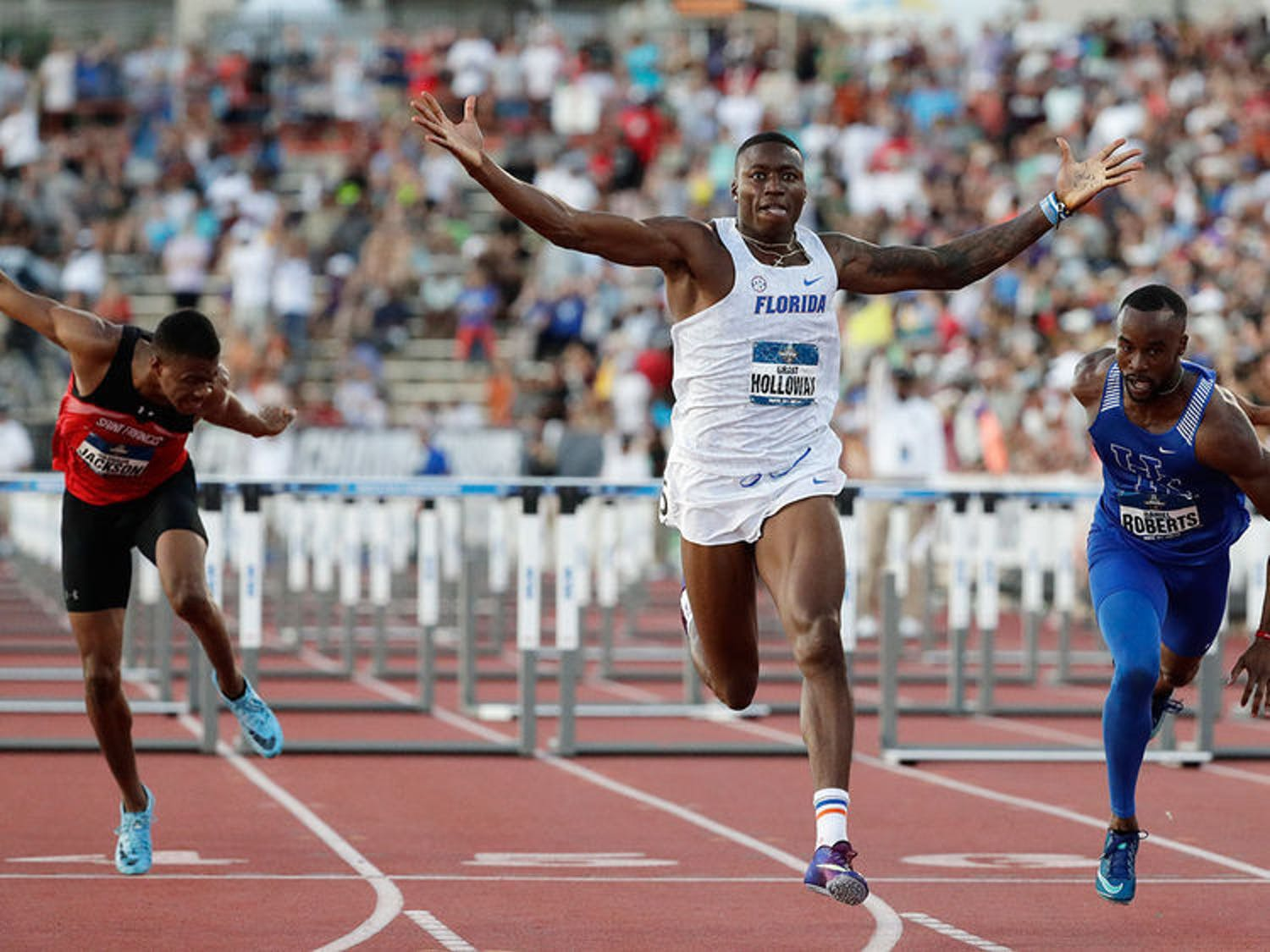 Grant Holloway won the final heat of the men's 110-meter hurdles Saturday to book his first ticket to the Olympic Games this summer in Tokyo.
