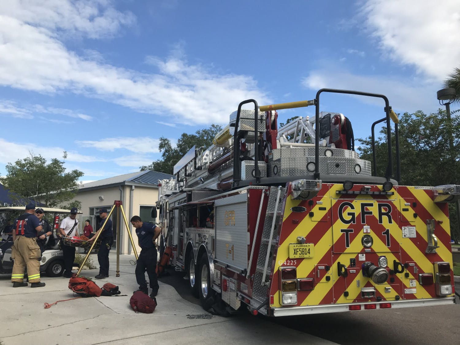 Gainesville firefighters set up one of their trucks outside of the Sante Fe Police Department where the expo was held.